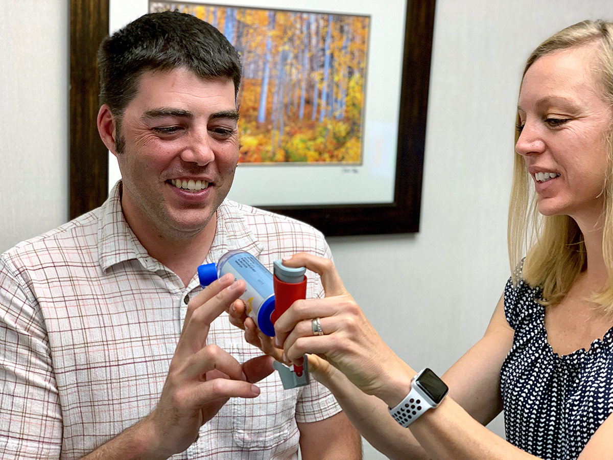 Patient receiving inhaler instructions at Allergy and Asthma Center of Western Colorado in Grand Junction, Colorado.